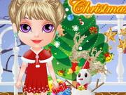 تلبيس الطفلة هالين ملابس عيد الميلاد
